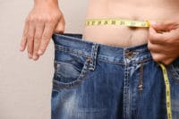 Men wearing big jeans after truSculpt in NYC